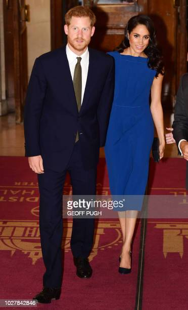 Britain's Prince Harry Duke of Sussex and his wife Meghan Duchess of Sussex arrive to attend 100 Days to Peace in London on September 6 a gala music...
