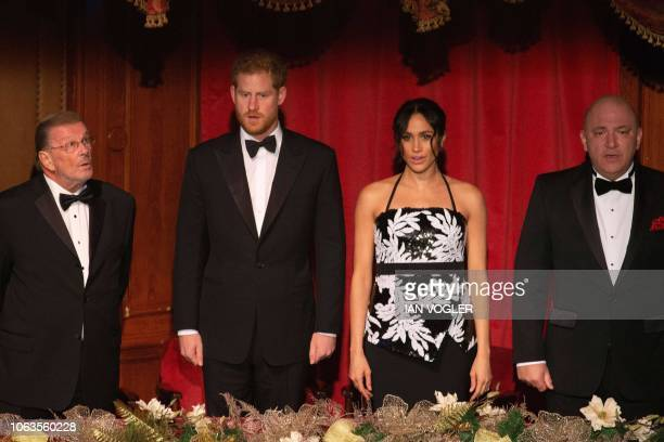 Britain's Prince Harry Duke of Sussex and his wife Meghan Duchess of Sussex attend the annual Royal Variety Performance at the Palladium Theatre in...