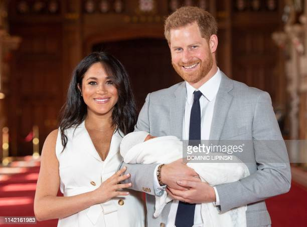 TOPSHOT Britain's Prince Harry Duke of Sussex and his wife Meghan Duchess of Sussex pose for a photo with their newborn baby son Archie Harrison...