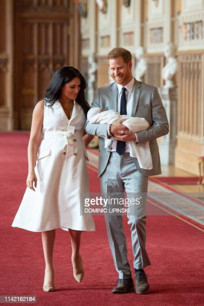 Britain's Prince Harry Duke of Sussex and his wife Meghan Duchess of Sussex pose for a photo with their newborn baby son Archie Harrison...