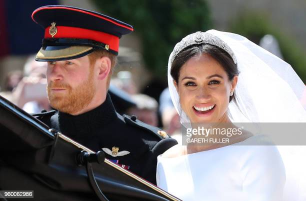 TOPSHOT Britain's Prince Harry Duke of Sussex and his wife Meghan Duchess of Sussex begin their carriage procession in the Ascot Landau Carriage...