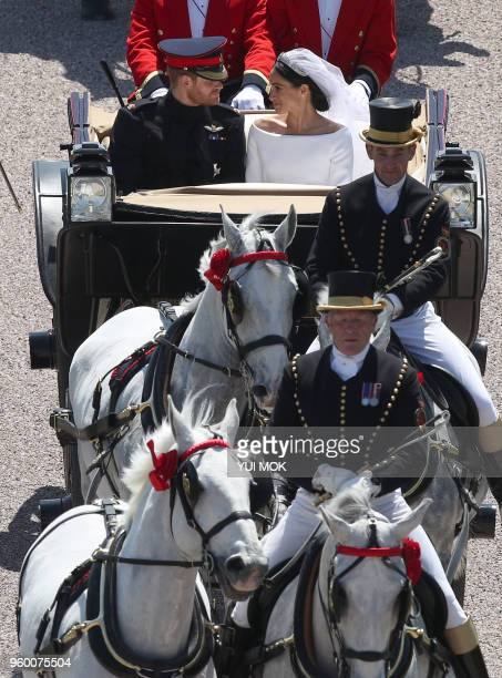 Britain's Prince Harry Duke of Sussex and his wife Meghan Duchess of Sussex are escorted by members of the Household Cavalry Mounted Regiment as they...