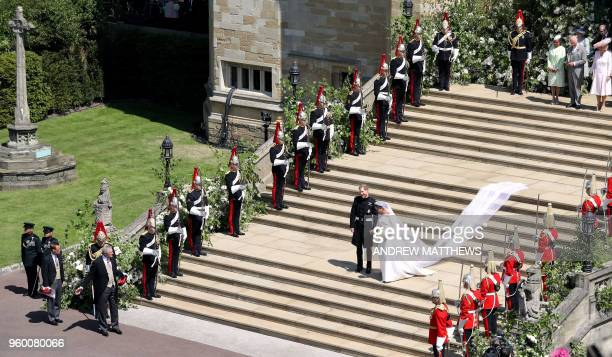 Britain's Prince Harry, Duke of Sussex and his wife Meghan, Duchess of Sussex walk down the west steps of St George's Chapel, Windsor Castle, in...