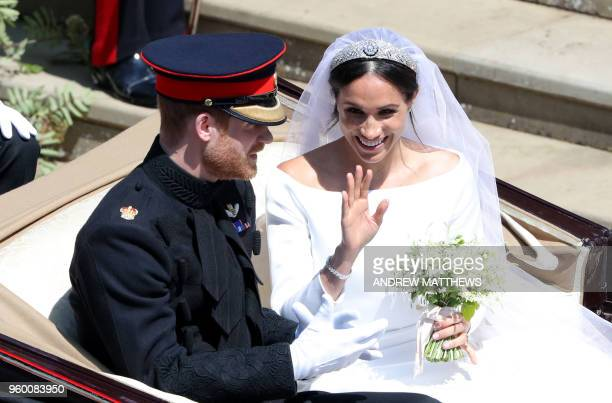 Britain's Prince Harry Duke of Sussex and his wife Meghan Duchess of Sussex get into the Ascot Landau Carriage after their wedding ceremony at St...