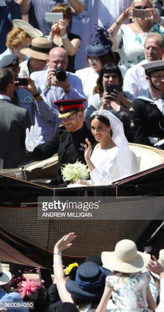 Britain's Prince Harry Duke of Sussex and his wife Meghan Duchess of Sussex begin their carriage procession in the The Ascot Landau carriage after...