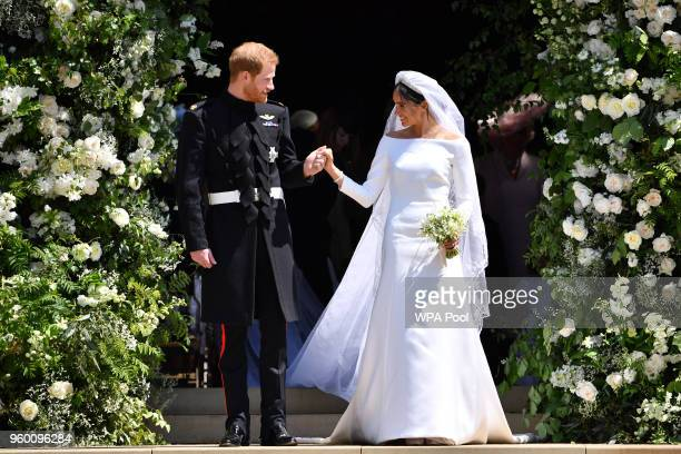 Britain's Prince Harry, Duke of Sussex and his wife Meghan, Duchess of Sussex leave from the West Door of St George's Chapel, Windsor Castle, in...