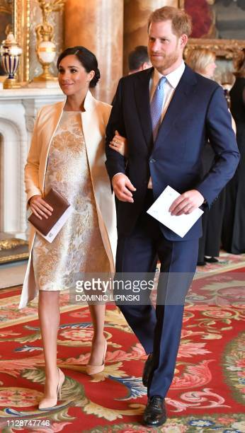 Britain's Prince Harry Duke of Sussex and Meghan Duchess of Sussex attend a reception to mark the 50th Anniversary of the investiture of The Prince...