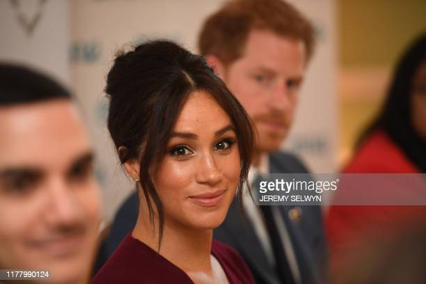 Britain's Prince Harry Duke of Sussex and Meghan Duchess of Sussex attend a roundtable discussion on gender equality with The Queens Commonwealth...
