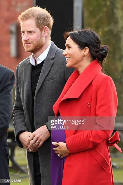 Britain's Prince Harry Duke of Sussex and Meghan Duchess of Sussex are greeted as they arrive to visit Birkenhead northwest England on January 14 2019