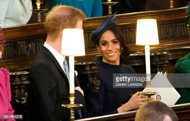 Britain's Prince Harry Duke of Sussex and Meghan Duchess of Sussex takes her seat inside St George's Chapel ahead of the wedding of Britain's...