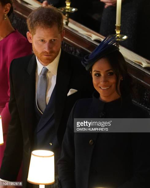 Britain's Prince Harry Duke of Sussex and Meghan Duchess of Sussex attend the wedding ceremony of Britain's Princess Eugenie of York and Jack...