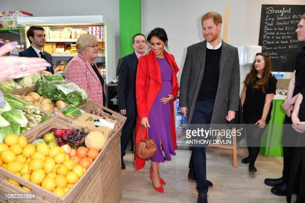 Britain's Prince Harry Duke of Sussex and Meghan Duchess of Sussex view produce displayed for sale as they officially open 'Number 7' a 'Feeding...