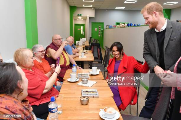 Britain's Prince Harry Duke of Sussex and Meghan Duchess of Sussex meet with local residents as they officially open 'Number 7' a 'Feeding...