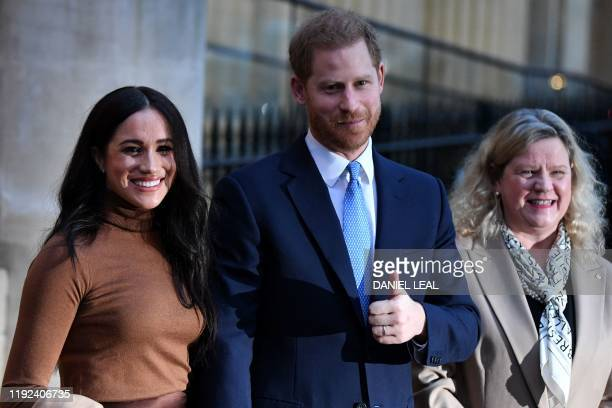 Britain's Prince Harry Duke of Sussex and Meghan Duchess of Sussex stand with Canada's High Commissioner for Canada in the United Kingdom Janice...