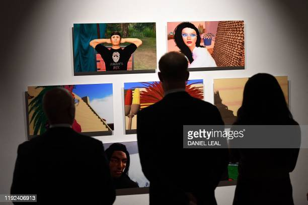 Britain's Prince Harry Duke of Sussex and Meghan Duchess of Sussex view artworks by Indigenous Canadian artist Skawennati in the Canada Gallery...