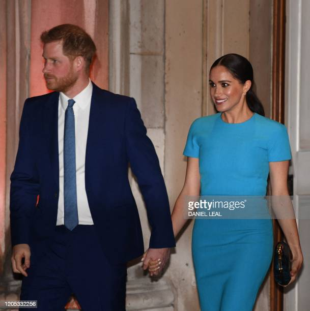 Britain's Prince Harry, Duke of Sussex , and Meghan, Duchess of Sussex leave after attending the Endeavour Fund Awards at Mansion House in London on...