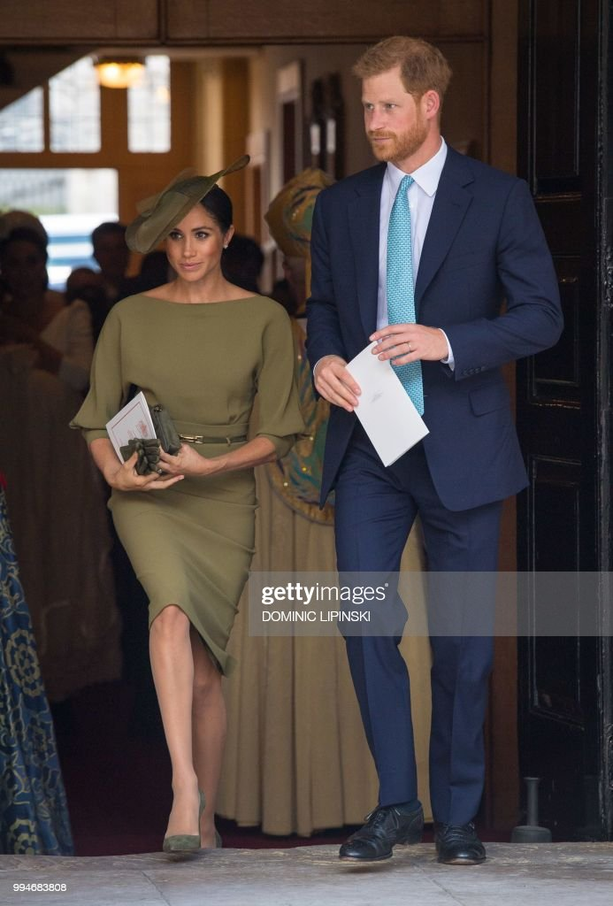 Britain's Prince Harry, Duke of Sussex and Meghan, Duchess of Sussex leave after the christening of Britain's Prince Louis of Cambridge at the Chapel Royal, St James's Palace, London on July 9, 2018.