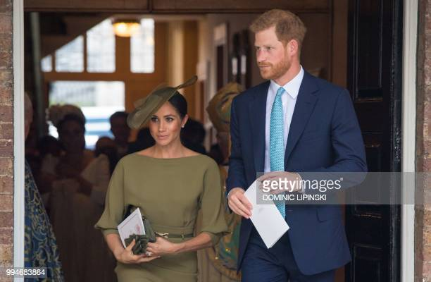 Britain's Prince Harry Duke of Sussex and Meghan Duchess of Sussex leave after the christening of Britain's Prince Louis of Cambridge at the Chapel...
