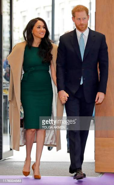 Britain's Prince Harry Duke of Sussex and Meghan Duchess of Sussex arrive to attend the annual WellChild Awards in London on October 15 2019...