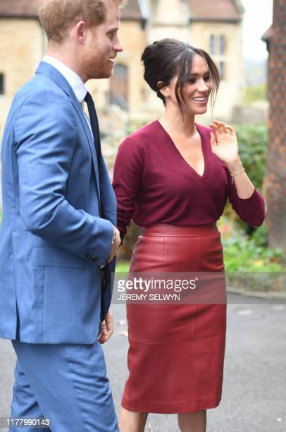 Britain's Prince Harry Duke of Sussex and Meghan Duchess of Sussex arrive to attend a roundtable discussion on gender equality with The Queens...