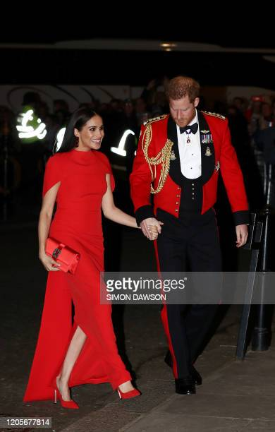 Britain's Prince Harry, Duke of Sussex and Meghan, Duchess of Sussex arrive to attend The Mountbatten Festival of Music at the Royal Albert Hall in...