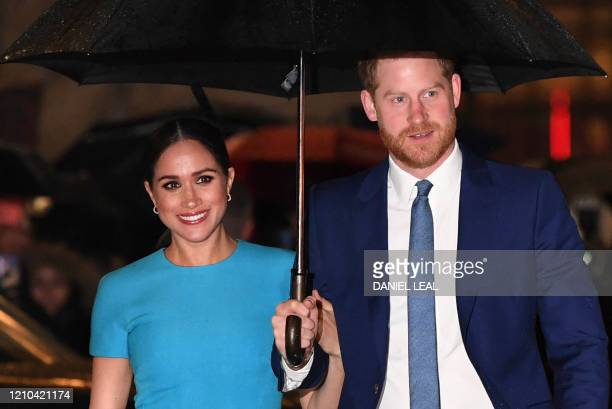 Britain's Prince Harry, Duke of Sussex and Meghan, Duchess of Sussex arrive to attend the Endeavour Fund Awards at Mansion House in London on March...