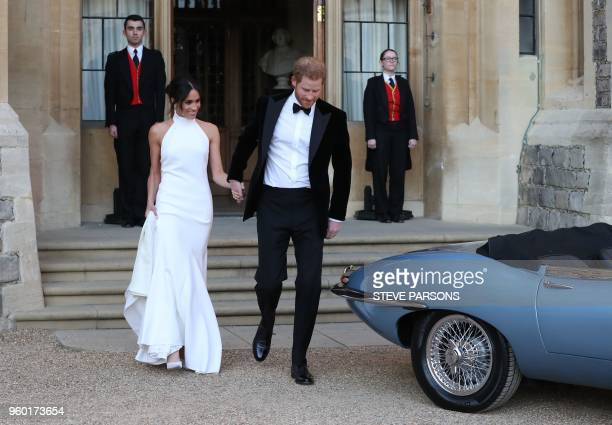 Britain's Prince Harry Duke of Sussex and Meghan Markle Duchess of Sussex leave Windsor Castle in Windsor on May 19 2018 after their wedding to...