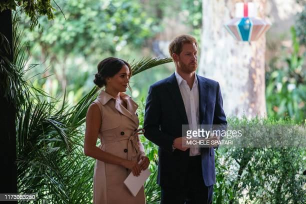 Britain's Prince Harry Duke of Sussex and Meghan the Duchess of Sussex stand on the stage at the British High Commissioner residency where they will...