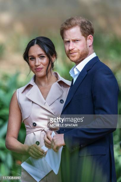 TOPSHOT Britain's Prince Harry Duke of Sussex and Meghan the Duchess of Sussex arrive at the British High Commissioner residency in Johannesburg...