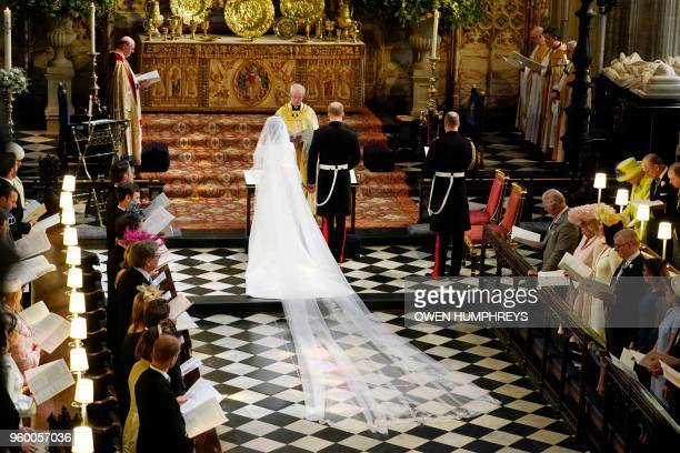 Britain's Prince Harry Duke of Sussex and US actress Meghan Markle stand at the altar together before Archbishop of Canterbury Justin Welby in St...