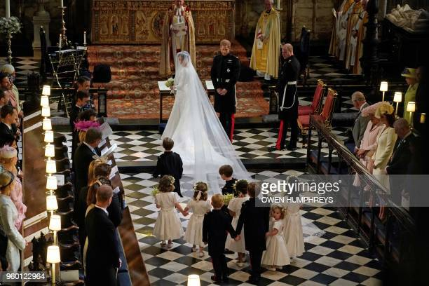Britain's Prince Harry Duke of Sussex and US actress Meghan Markle stand at the altar with their bridsesmaids and page boys in St George's Chapel...