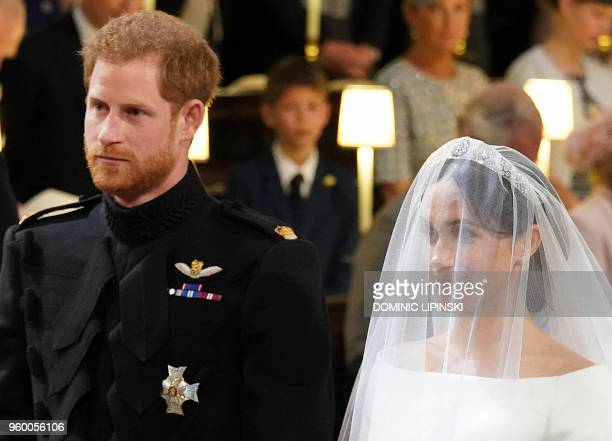 Britain's Prince Harry Duke of Sussex and US actress Meghan Markle stand together at the altar in St George's Chapel Windsor Castle in Windsor on May...