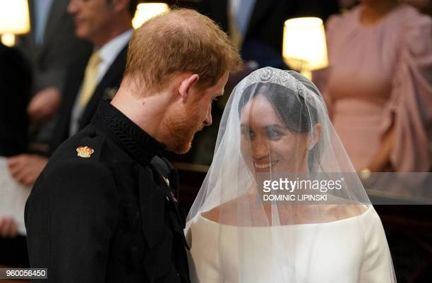 TOPSHOT Britain's Prince Harry Duke of Sussex and US actress Meghan Markle stand together at the altar in St George's Chapel Windsor Castle in...