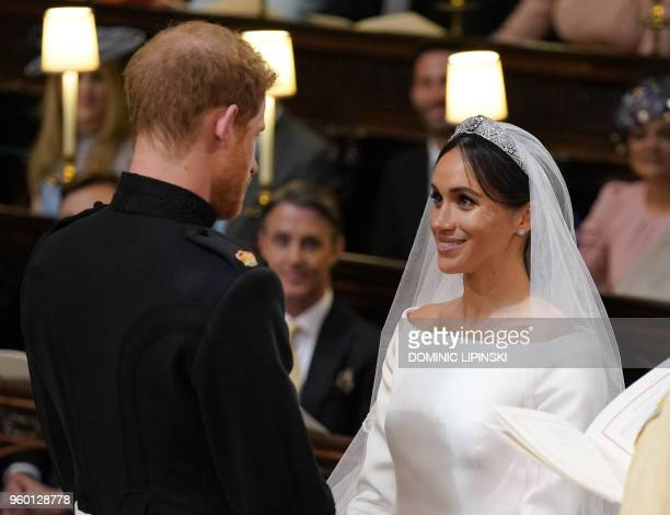 Britain's Prince Harry Duke of Sussex and US fiancee of Britain's Prince Harry Meghan Markle during their wedding ceremony in St George's Chapel...