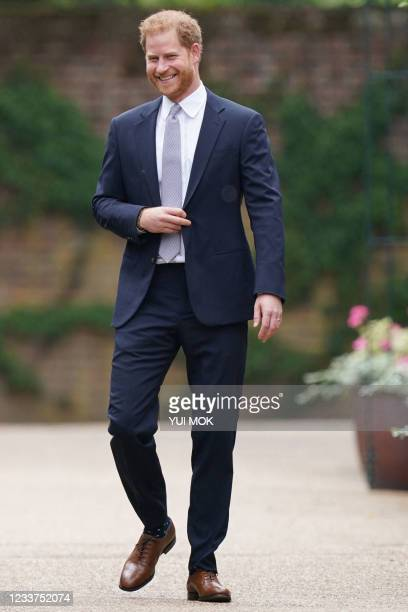 Britain's Prince Harry, Duke of Sussex, arrives for the unveiling of a statue of their mother, Princess Diana at The Sunken Garden in Kensington...