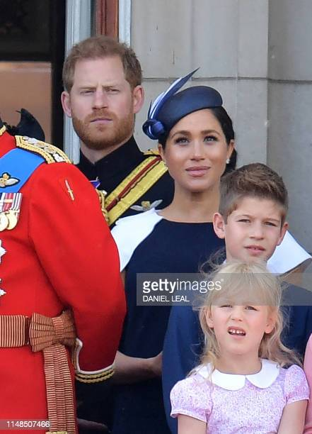 Britain's Prince Harry Duke of Sussex Britain's Meghan Duchess of Sussex James Viscount Severn and Isla Phillips stand with other members of the...