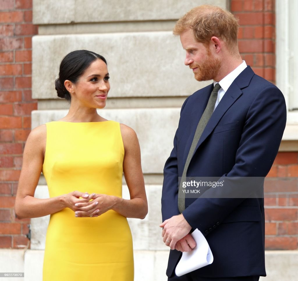 Britain's Prince Harry, Duke of Sussex (R), Britain's Meghan, Duchess of Sussex arrive to attend a reception marking the culmination of the Commonwealth Secretariats Youth Leadership Workshop, at Marlborough House in London on July 5, 2018.