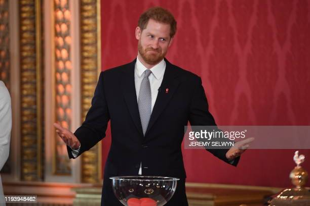 Britain's Prince Harry, Duke of Sussex gestures during the draw for the Rugby League World Cup 2021 at Buckingham Palace in London on January 16,...