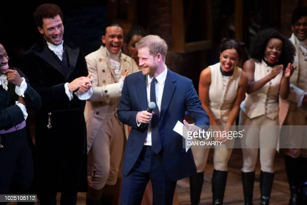 Britain's Prince Harry Duke of Sussex gives a speech with the cast and crew after a gala performance of the musical 'Hamilton' in support of the...