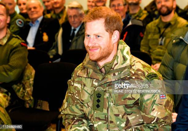 Britain's Prince Harry Duke of Sussex is welcomed by meets soldiers on February 14 2019 as he arrives at the military base of Bardufoss The Duke of...