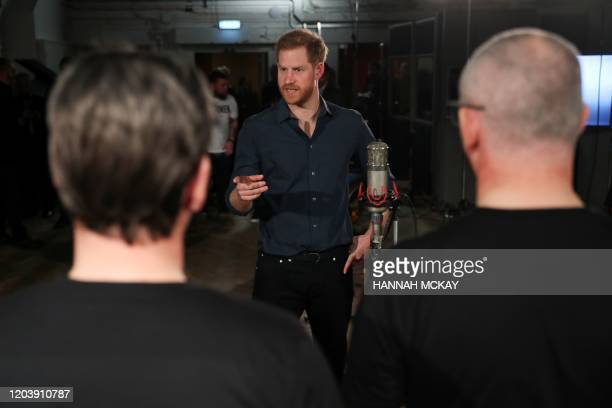 Britain's Prince Harry Duke of Sussex meeets with members of the Invictus Games Choir during his meeting with US singer Jon Bon Jovi at Abbey Road...