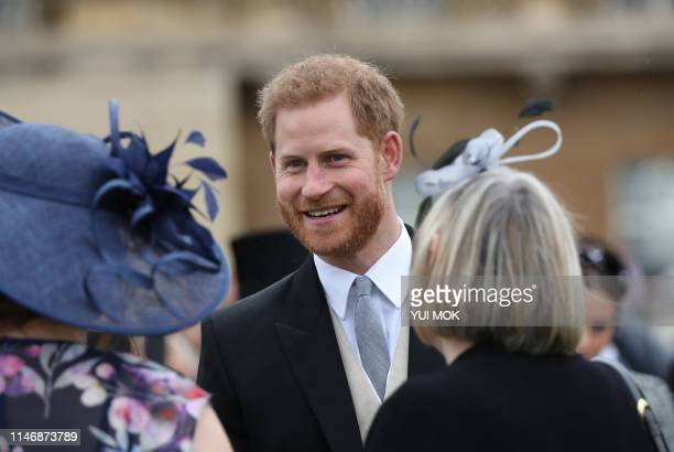 Britain's Prince Harry Duke of Sussex meets guests at the Queen's Garden Party in Buckingham Palace central London on May 29 2019
