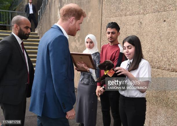 Britain's Prince Harry Duke of Sussex meets students during a visit to Nottingham Academy on October 10 2019 in Nottingham central England to mark...