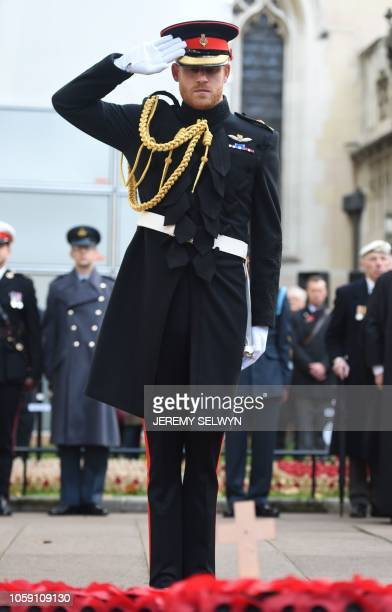 Britain's Prince Harry, Duke of Sussex, salutes after laying a Cross of Remembrance in front of wooden crosses from the Graves of Unknown British...