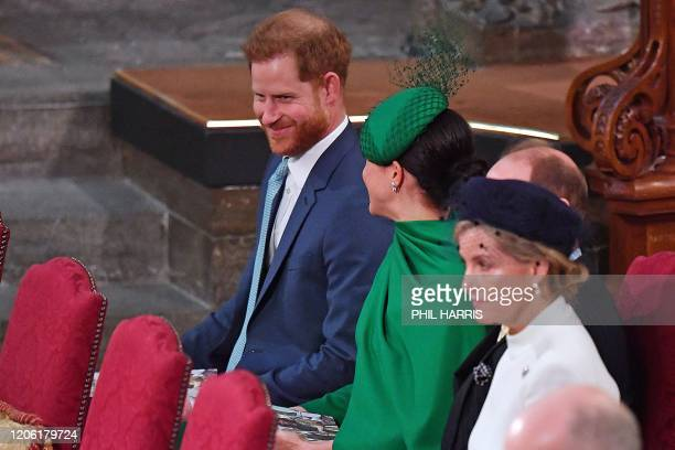 Britain's Prince Harry Duke of Sussex sits beside his wife Britain's Meghan Duchess of Sussex inside Westminster Abbey as they attend the annual...