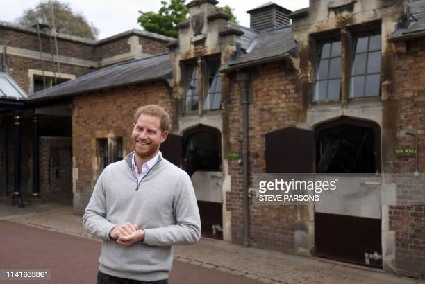Britain's Prince Harry, Duke of Sussex, speaks to members of the media at Windsor Castle in Windsor, west of London on May 6 following the...