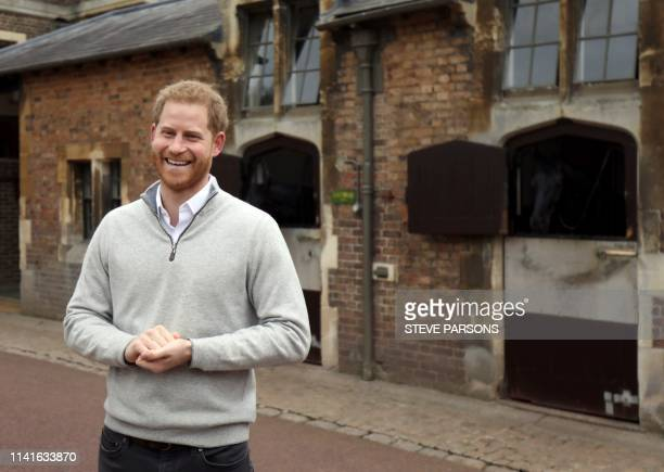 TOPSHOT Britain's Prince Harry Duke of Sussex speaks to members of the media at Windsor Castle in Windsor west of London on May 6 following the...