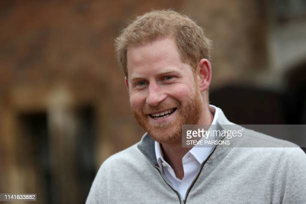 Britain's Prince Harry Duke of Sussex speaks to members of the media at Windsor Castle in Windsor west of London on May 6 following the announcement...