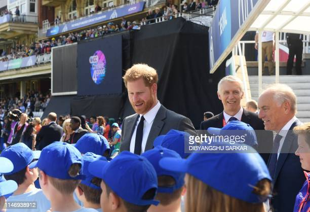Britain's Prince Harry Duke of Sussex speaks with children during an opening ceremony before the start of the 2019 Cricket World Cup group stage...