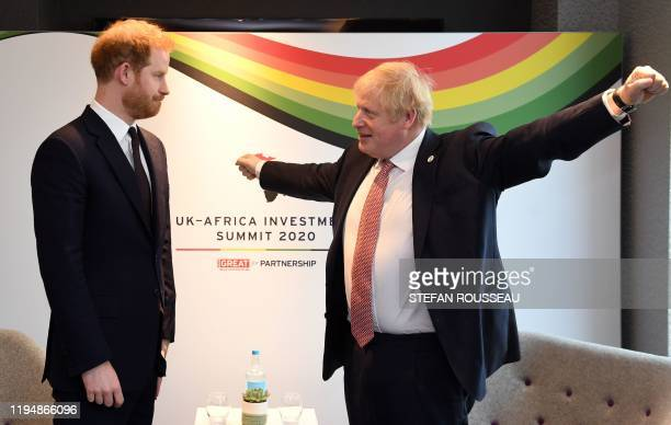 Britain's Prince Harry, Duke of Sussex talks with Britain's Prime Minister Boris Johnson during a bilteral meeting at the UK-Africa Investment Summit...